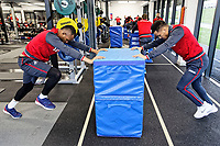 (L-R) Jordan Ayew and Matrin Olsson exercise in the gym during the Swansea City Training and Press Conference at The Fairwood Training Ground, Swansea, Wales, UK. Thursday 08 February 2018