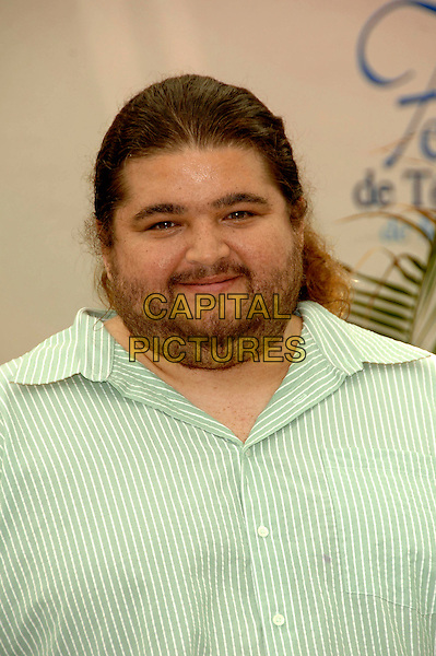 "JORGE GARCIA .Photocall promoting the television series ""Lost"" on the fourth day of the 2008 Monte Carlo Television Festival held at Grimaldi Forum, Monaco, Principality of Monaco..June 11th, 2008.headshot portrait green striped stripes shirt stubble facial hair.CAP/TTL .© TTL/Capital Pictures"