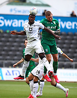 5th July 2020; Liberty Stadium, Swansea, Glamorgan, Wales; English Football League Championship, Swansea City versus Sheffield Wednesday; Marc Guehi of Swansea City jumps to head the crossed ball to safety