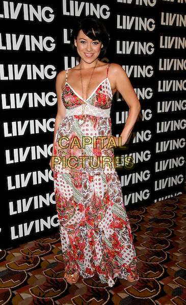 LISA SCOTT-LEE.Attending the Living TV Summer Schedule Launch event at China Tang, Park Lane, London, England, UK,. May 14th 2008.full length red and cream white lace crochet floral print patterned maxi dress bob fringe paisley hand on hip.CAP/CAN.©Can Nguyen/Capital Pictures