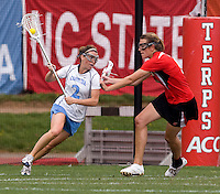 Megan Bosica (2) of North Carolina is defended by Laura Merrifield (9) of Maryland during the ACC women's lacrosse tournament finals in College Park, MD.  Maryland defeated North Carolina, 10-5.