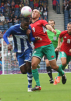Men's Olympic Football match Honduras v Morocco on 26.7.12...Jose Velasquez of Honduras challenges with Noureddine Amrabat of Morocco, during the Honduras v Morocco Men's Olympic Football match at Hampden Park, Glasgow.........