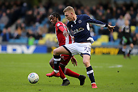 Brentford's Romaine Sawyers and Millwall's George Saville challenge for the ball during Millwall vs Brentford, Sky Bet EFL Championship Football at The Den on 10th March 2018