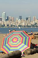 Colourful beach umbrella on Jericho Beach, Vancouver, British Columbia, Canada