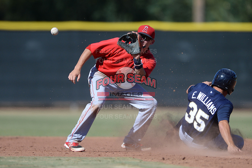 Los Angeles Angels second baseman Kody Eaves (21) waits for a throw as Eric Williams (35) slides in during an Instructional League game against the Milwaukee Brewers on October 11, 2013 at Tempe Diablo Stadium Complex in Tempe, Arizona.  (Mike Janes/Four Seam Images)