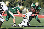 Manhattan Beach, CA 10/27/11 - Michael Pettis (Peninsula #75), Tanner Otto (Mira Costa #54) and Zac Johnson (Mira Costa #31) in action during the Peninsula vs Mira Costa Junior Varsity football game.