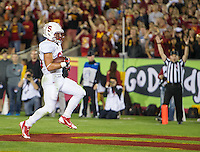 LOS ANGELES, CA - November 16, 2013:  Stanford Cardinal running back Tyler Gaffney (25) scores a touchdown during the Stanford Cardinal vs the USC Trojans at Los Angeles Memorial Coliseum in Los Angeles, CA. Final score Stanford Cardinal 17, USC Trojans  20.