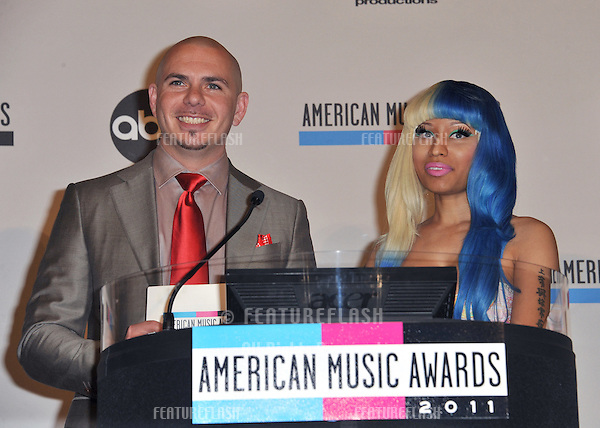 Nicki Minaj & Pitbull at the nominations announcement for the 2011 American Music Awards at the JW Marriott Los Angeles at LA Live..October 11, 2011  Los Angeles, CA.Picture: Paul Smith / Featureflash