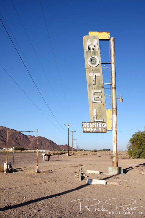 Weathered motel sign along Route 66 in Newberry Springs, California. Prior to the construction of Interstate 40 Route 66 was the primary road through the Mojave Desert