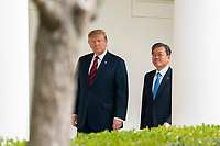 US President Donald J. Trump (L) and Korean President Moon Jae-in (R) walk along the Colonnade of the White House in Washington, DC, USA, 11 April 2019. President Moon is expected to ask President Trump to reduce sanctions on North Korea in an attempt to jump start nuclear negotiations between North Korea and the US.<br /> Credit: Jim LoScalzo / Pool via CNP/AdMedia