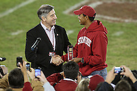 STANFORD, CA - NOVEMBER 21:  Bob Bowlsby presents Tiger Woods his Hall of Fame award during Stanford's 34-28 loss to the California Golden Bears in112th Big Game on November 21, 2009 at Stanford Stadium in Stanford, California.