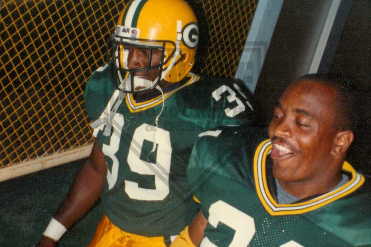 GREEN BAY - AUGUST 1990: Darrell Thompson (39) and Brent Fullwood (21) of the Green Bay Packers take the field prior to a game on August 11, 1990 at Lambeau Field in Green Bay, Wisconsin. (Photo by Brad Krause)