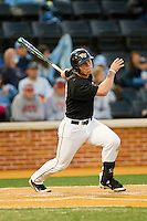Jimmy Redovian (23) of the Wake Forest Demon Deacons follows through on his swing against the North Carolina Tar Heels at Wake Forest Baseball Park on March 9, 2013 in Winston-Salem, North Carolina.  The Tar Heels defeated the Demon Deacons 20-6.  (Brian Westerholt/Four Seam Images)
