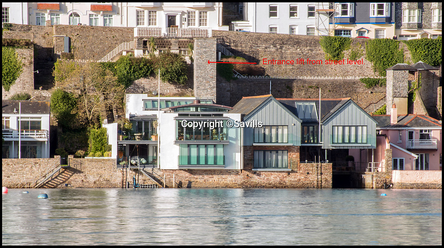 BNPS.co.uk (01202 558833)<br /> Pic: Savills/BNPS<br /> <br /> Right on the water...accessed by lift from the street above.<br /> <br /> An award-winning waterfront home that has spectacular seaside views has gone on the market for £5m.<br /> <br /> The aptly named River House sits right on the Dart Estuary in Devon and has been so cleverly designed there is a glass floor in the master bedroom that looks down on the water.<br /> <br /> Its main living areas have floor-to-ceiling bi-fold doors and glass Juliet balconies to give the property a feel of Venice rather than Devon.<br /> <br /> Interestingly, the five bedroom house is being sold along with a nearby two bedroom town house that is owned by the same vendors.