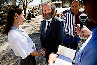 "Niland, California, March 1, 2008 - Ben and Moria Morofsky exchange vows before Alan Franklin, and best man, Earnie Loza in front of the Range music venue. The Morofsky's, who have been together for 14 years, are only the second couple to tie the knot in Slab City. Ben says, ""Since the County came and stole my kids from me, Moria is all I got left. Without her I would have done killed myself by now. She is all I got now."" ."