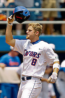 June 12, 2011:    Florida Gators outfielder Daniel Pigott (8) acknowledges the crowd after scoring on a home run during NCAA Gainesville Super Regional Game 3 action between Florida Gators and Mississippi State Bulldogs played at Alfred A. McKethan Stadium on the campus of Florida University in Gainesville, Florida.  Florida defeated Mississippi State 8-6 to advance to the College World Series in Omaha, Nebraska........