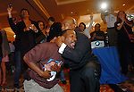 Obama supporter Eric Jones is overcome with emotion and comforted by Bobby Jackson after the race was 'called' at the Tampa Marriott Waterside.