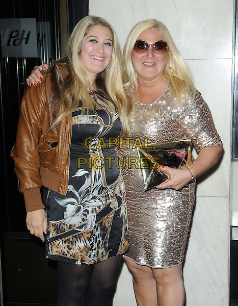 Saskia Kurer & Vanessa Feltz.attended David Gest & Patsy Palmer's joint 'Music & Magic' birthday celebration to help raise funds for the Me&Dee Charity, Grand Connaught Rooms, Great Queen St., London, England, UK, .11th May 2012..half length mother daughter family gold sequined sequin dress brown leather jacket black print sunglasses .CAP/CAN.©Can Nguyen/Capital Pictures.