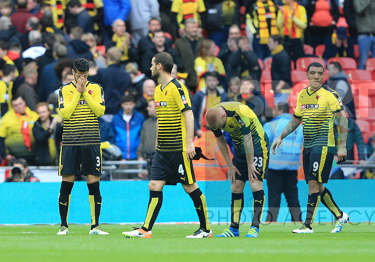 Watford's MIguel Britos and Troy Deeney look on dejected at the final whistle of the Emirates FA Cup, Semi-Final match at Wembley Stadium, London.  Photo credit should read: David Klein/Sportimage