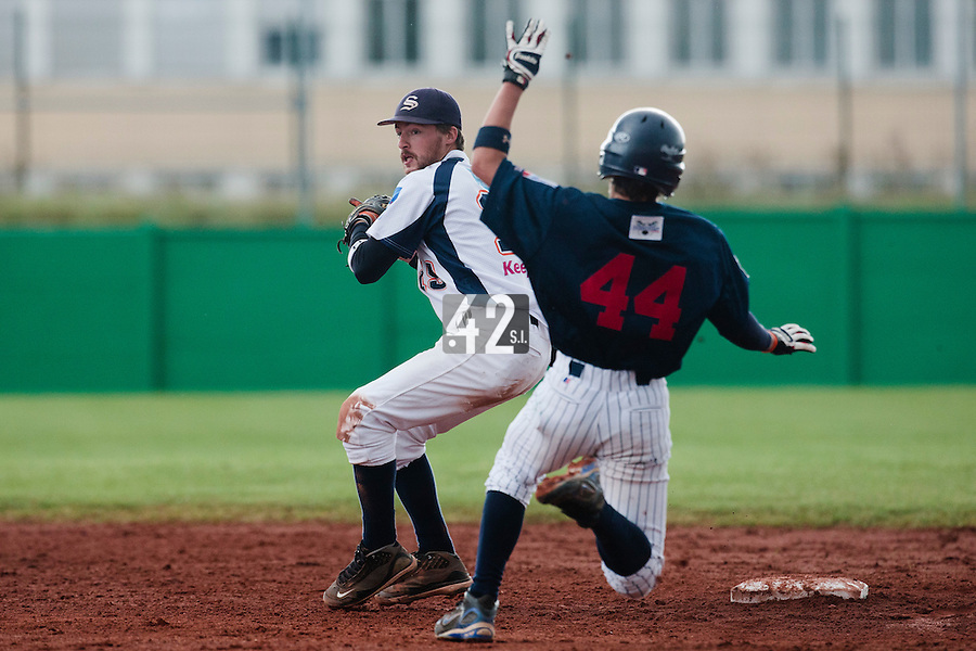 16 October 2010: Romain Martinez-Scott of Savigny throws the ball to first base for a double play during Rouen 16-4 win over Savigny, during game 1 of the French championship finals, in Savigny sur Orge, France.