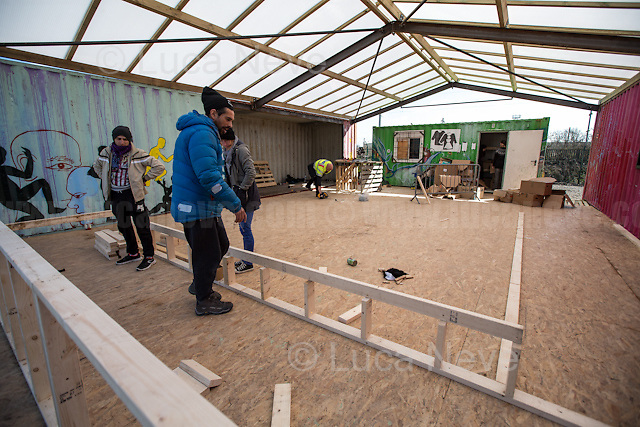 Work in progress: one of the new kitchens.<br /> <br /> Dunkirk Camp.<br /> <br /> Under the Sky of Calais &amp; Dunkirk. Two Camps, Two Sides of the Same Coin: Not 'migrants', Not 'refugees', just Humans.<br /> <br /> France, 24-30/03/2016. Documenting (and following) Zekra and her experience in the two French camps at the gate of the United Kingdom: Calais' &quot;Jungle&quot; and Dunkirk's &quot;Grande-Synthe&quot;. Zekra lives in London but she is originally from Basra in Iraq. Zekra and her family had to flee Kuwait - where they moved for working reason - due to the &quot;Gulf War&quot;, and to the Western Countries' will to &quot;export Democracy in Iraq&quot;. Zekra is a self-motivated volunteer and founder of &quot;Happy Ravers&quot;, a group of people (not a NGO or a charity) linked to each other because of their love for rave parties but also men and women who meet up every week to help homeless people and other people in need in Central London. (Here there are some of the stories I covered about Zekra and &quot;Happy Ravers&quot;: http://bit.ly/1XVj1Cg &amp; http://bit.ly/24kcGQz &amp; http://bit.ly/1TY0dPO). Zekra worked as an English teacher in the adult school at Dunkirk's &quot;Grande-Synthe&quot; camp and as a cultural mediator and Arabic translator for two medic teams in Calais' &quot;Jungle&quot;. Please read her story at the beginning of this reportage.