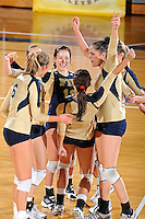 17 November 2011:  FIU's team (pictured, Chanel Araujo (13), Jessica Egan (6), Silvia Carli (9), Andrea Lakovic (1), Marija Prsa (10), Jovana Bjelica (16)) celebrates winning a point in the first set as the FIU Golden Panthers defeated the Denver University Pioneers, 3-1 (25-21, 23-25, 25-21, 25-18), in the first round of the Sun Belt Conference Tournament at U.S Century Bank Arena in Miami, Florida.