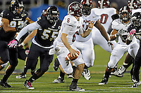 25 October 2011:  FIU linebacker Gregory Hickman (55) pressures Troy quarterback Corey Robinson (6) in the second quarter as the FIU Golden Panthers defeated the Troy University Trojans, 23-20 in overtime, at FIU Stadium in Miami, Florida.