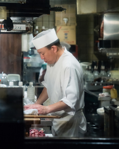 A cook in a small izakaya catering to salarymen.