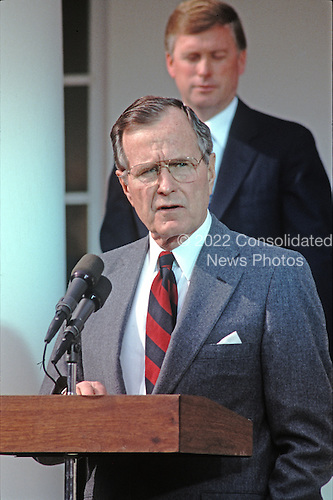 United States President George H.W. Bush reads a statement rejecting the proposed Soviet peace agreement to end the Gulf War with Iraq in the Rose Garden of the White House in Washington, D.C. on February 22, 1991.  U.S. Vice President Dan Quayle stands behind the President.<br /> Credit: Howard L. Sachs / CNP
