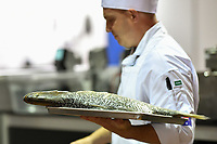 Melbourne, 30 May 2017 - Michael Cole of the Georgie Bass Cafe & Cookery in Flinders walks with a barramundi fish at the Australian selection trials of the Bocuse d'Or culinary competition held during the Food Service Australia show at the Royal Exhibition Building in Melbourne, Australia. Photo Sydney Low
