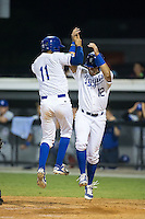 Michael Arroyo (11) of the Burlington Royals celebrates with teammate Gabriel Cancel (12) after hitting a 2-run home run against the Bluefield Blue Jays at Burlington Athletic Stadium on June 27, 2016 in Burlington, North Carolina.  The Royals defeated the Blue Jays 9-4.  (Brian Westerholt/Four Seam Images)