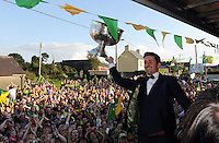 27-9-2014:   Aidan O'Mahony hoists Sam at the Kerry Team homecoming in Rathmore, County Kerry last evening.<br /> Picture by Don MacMonagle