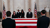 United States President Barack Obama and First Lady Michelle Obama  pay their respects to Supreme Court Justice Anthony Scalia, in front of the casket bearing his body, in the Great Hall of the Supreme Court, Washington, DC, February 19, 2016.  Anthony Scalia died February 13, 2016, at age 79, during a hunting trip in West Texas. <br /> Credit: Aude Guerrucci / Pool via CNP