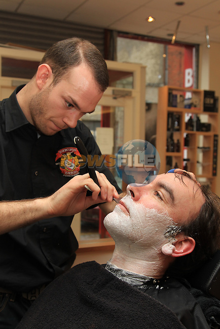Town centre barbers hot shave.Picture: Fran Caffrey/www.newsfile.ie.