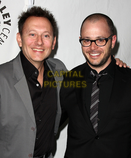 MICHAEL EMERSON & DAMON LINDELOF.27th Annual PaleyFest Presents the television show 'Lost' held At The Saban Theatre, Beverly Hills, California, USA, 27th February 2010..arrivals half length jacket blazer black tie glasses beard facial hair shirt grey gray suit shirt arm around shoulder .CAP/ADM/KB.©Kevan Brooks/Admedia/Capital Pictures