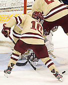 Danny Linell (BC - 10) clears the puck out of danger. - The Boston College Eagles defeated the visiting University of New Hampshire Wildcats 4-3 on Friday, January 27, 2012, in the first game of a back-to-back home and home at Kelley Rink/Conte Forum in Chestnut Hill, Massachusetts.