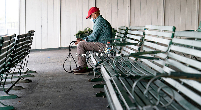 The normally crowded main walkway stands mostly empty, with the exception of essential workers at Belmont race track in Elmont, New York, USA, 20 June 2020. The Belmont is being run without fans due to coronavirus SARS-CoV-2 which causes the Covid-19 disease and while it has always been the third leg of the Triple Crown, due to Covid-19 it is, instead the first leg in 2020.