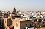 Cityscape view over rooftops the Iglesia de la Anunciación in foreground, Seville, Spain