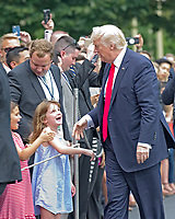 United States President Donald J. Trump and guests as he arrives at the White House in Washington, DC following a trip from Miami, Florida on Friday, June 16, 2017.  In Miami, the President gave remarks and participated in a signing on the United States&rsquo; policy towards Cuba.<br /> Credit: Ron Sachs / CNP /MediaPunch