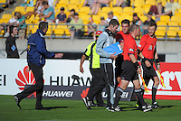Phoenix coach Ernie Merrick raises a point with match officials at halftime during the A-League football match between Wellington Phoenix and Brisbane Roar at Westpac Stadium, Wellington, New Zealand on Saturday, 14 December 2013. Photo: Dave Lintott / lintottphoto.co.nz