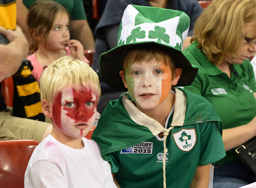 Two young Fans enjoying the atmosphere <br /> <br /> Photographer Ian Cook/CameraSport<br /> <br /> Rugby Union - 2015 Rugby World Cup - Canada v Ireland - Saturday 19th September 2015 - Millennium Stadium - Cardiff<br /> <br /> &copy; CameraSport - 43 Linden Ave. Countesthorpe. Leicester. England. LE8 5PG - Tel: +44 (0) 116 277 4147 - admin@camerasport.com - www.camerasport.com