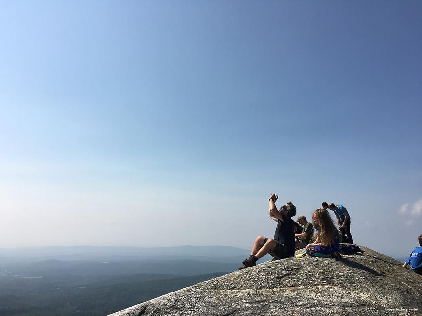 Orange N.H., Monday, Aug. 21, 2017:  People watching partial solar eclipse atop Mount Cardigan. (Photo by Cheryl Senter)