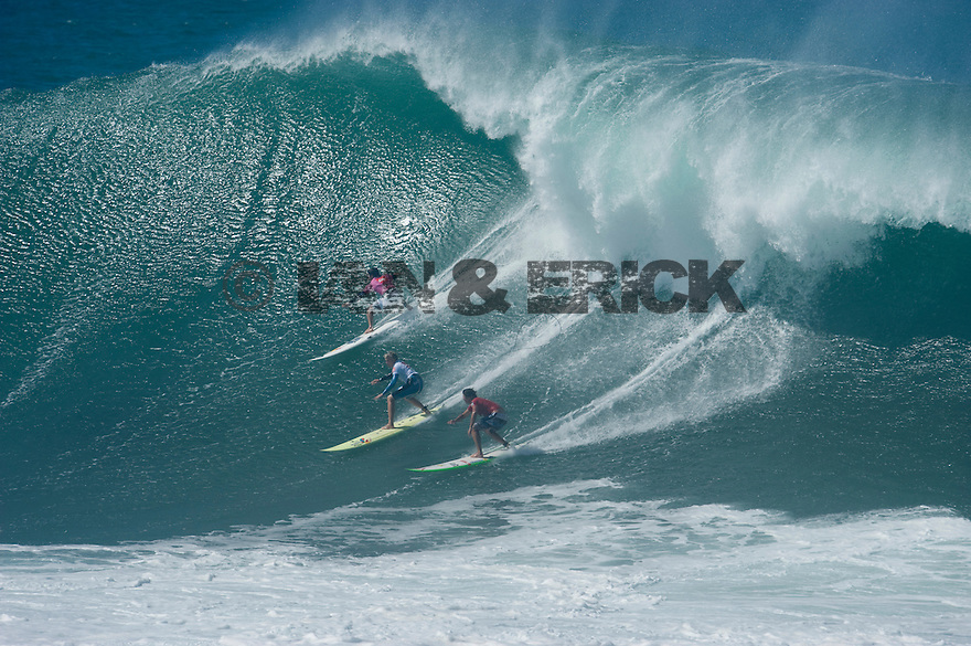 Carlos Burle (BRZ), Jamie O'brien (HAW) and Reef McItosh (HAW) during the Quiksilver Eddie Aikau at Waimea Bay on the Northshore of Oahu in Hawaii