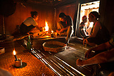 INDONESIA, Flores, Ngada District, a chicken is sacrificed and then prepared for a meal at Belaraghi village