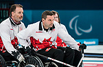 PyeongChang 14/3/2018 - Alternate Jamie Anseeuw steadies skip Mark Ideson as Canada takes on Slovakia in wheelchair curling at the Gangneung Curling Centre during the 2018 Winter Paralympic Games in Pyeongchang, Korea. Photo: Dave Holland/Canadian Paralympic Committee