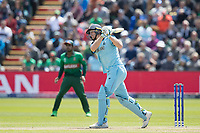 Jos Buttler (England) drives Mustafizur Rahman (Bangladesh) straight back over long on for six during England vs Bangladesh, ICC World Cup Cricket at Sophia Gardens Cardiff on 8th June 2019