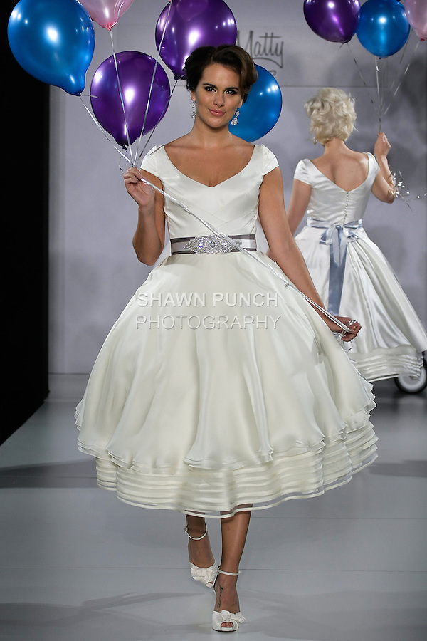 Model walks runway in a Hope wedding dress from the Matty by Matthew Christopher Spring 2013 collection, at the Couture Show, during New York Bridal Fashion Week Spring 2013.