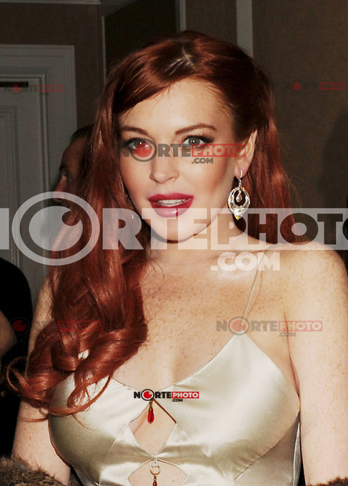 BEVERLY HILLS, CA - NOVEMBER 20: Lindsay Lohan arrives at the 'Liz & Dick' - Los Angeles Premiere at the Beverly Hills Hotel on November 20, 2012 in Beverly Hills, California.PAP1112JP318..PAP1112JP318.. /NortePhoto