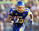 BROOKINGS, SD - AUGUST 31:  Brandon Hubert #23 from South Dakota State University breaks loose for a gain against Butler in the first quarter Saturday evening at Coughlin Alumni Stadium in Brookings. (Photo by Dave Eggen/Inertia)