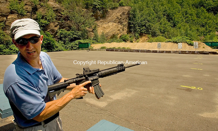 WATERBURY, CT --JULY 03, 2008-070308JS05-Waterbury police officer Sgt. David Silverio prepares to demonstrate the features of the Smith &amp; Wesson Model M&amp;P 15 rifle on Thursday at the gun range on Thomaston Ave. in Waterbury. The Waterbury Police have made changes in the department's tatical equipment as well as the sidearm's the officers carry. <br /> Jim Shannon/Republican-American